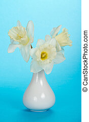 Bouquet of white narcissuses in a ceramic vase