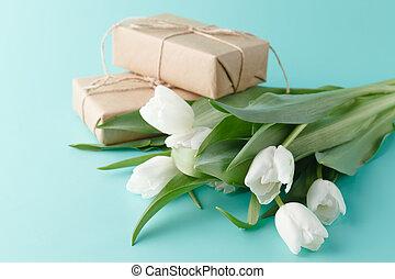 bouquet of white spring tulips on plain aquamarine background