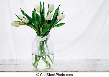 Bouquet of white tulips in a vase