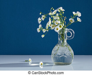 Bouquet of wild flowers in glass vase