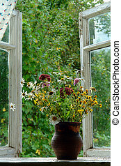 bouquet of wild flowers on the window