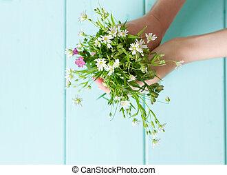 bouquet of wildflowers in hands