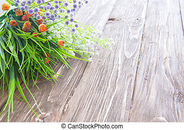 Bouquet of wildflowers on wooden. Wild flowers on an old wooden background