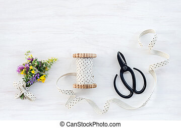 Bouquet of wildflowers with ribbon and scissors