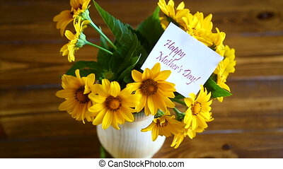 bouquet of yellow big daisies on a wooden table