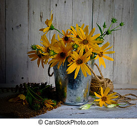Bouquet of yellow  flowers in pot on the stil life