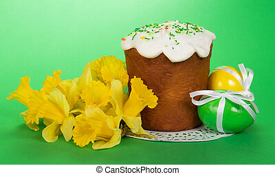 Bouquet of yellow narcissuses, Easter cake on a napkin and...