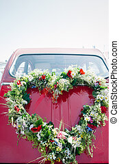 Bouquet on a red wedding car - Heart shape bouquet on the...