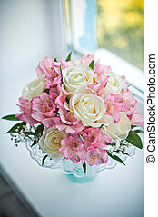 Bouquet on a window sill.