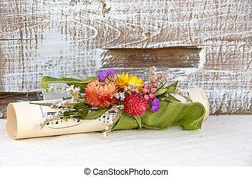 bouquet on sheet music