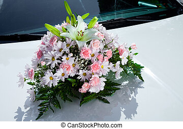 Bouquet on the wedding car