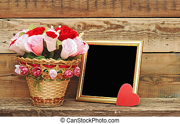 bouquet paper flower in a basket with blank photoframe