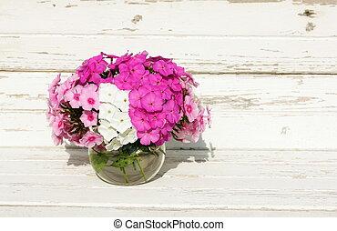 Bouquet Phlox flowers in glass bowl