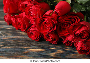 Bouquet red roses on wooden background, close up