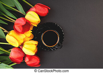 Bouquet red tulips and cup of coffee