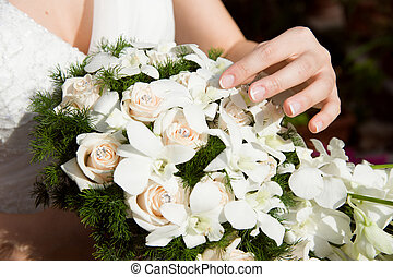 bouquet with bride hand