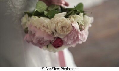 Bouquet with peonies in bride hands