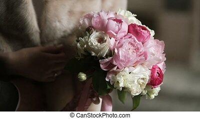 Bouquet with peonies in bride hands