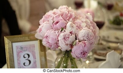 Bouquet with peonies on a table decoration