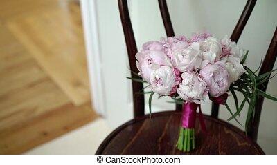 Bouquet with pink peonies indoors