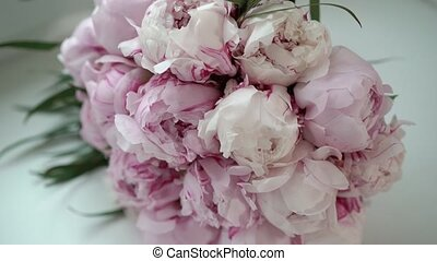 Bouquet with pink peonies on white background