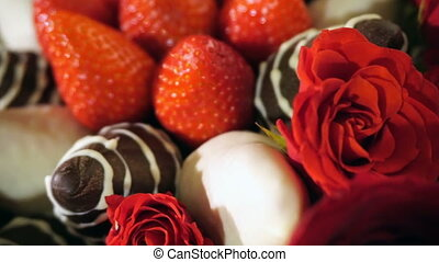 Bouquet with rose and strawberry in chocolate frosting. Rotation movie.