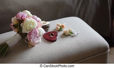 Bouquet with white and pink peonies on chair