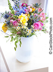 Bouquet with wild flowers in white vase