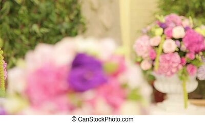 Bouquets of beautiful flowers in focus, wase