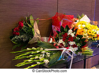 Bouquets of flowers  lie on a table in the banquet hall
