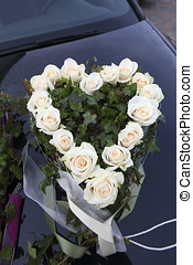 Bouquets of flowers on wedding car