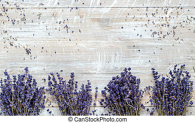 bouquets of lavender on a wooden table top view