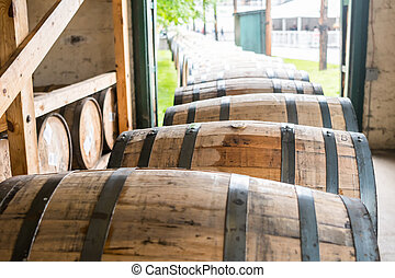 Bourbon Barrels Heading for Aging Warehouse in a line