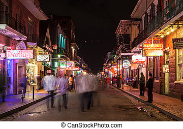 Bourbon St in the French Quarter at night in New Orleans, Louisiana, USA