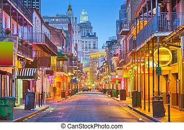 Bourbon St, New Orleans, Louisiana, USA cityscape of bars and retaurants at twilight.
