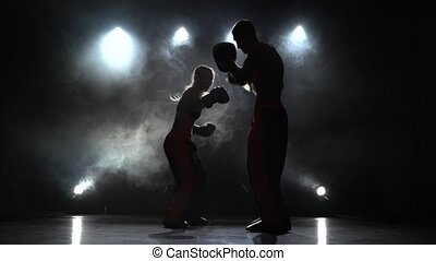 Bout the guy and the girl on the boxing paws . Light from...