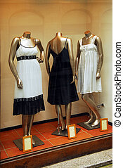 Boutique window - Boutique display window with mannequins in...