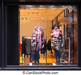 Boutique with dressed mannequins
