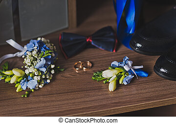 Boutonniere and mens wardrobe items on the table before the holiday 6
