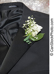 Boutonniere - Grooms tuxedo with boutonniere on his wedding ...