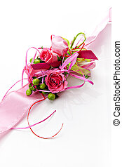 boutonniere of pink roses on a pink ribbon on a white ...