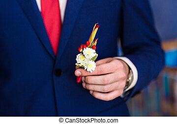 Boutonniere - Posed groom with rose button hole. Wedding ...