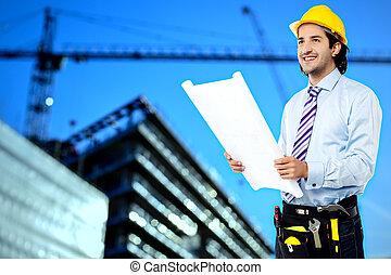 bouwschets, de arbeider van de bouw, het herzien