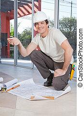 bouwschets, de arbeider van de bouw