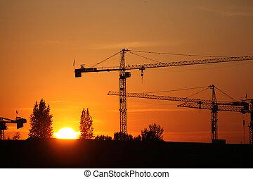 bouwsector, ondergaande zon , bouwterrein