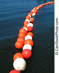 bouy o bouy - string of bouys floating in the water to mark ...