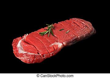 bovine meat on a black background