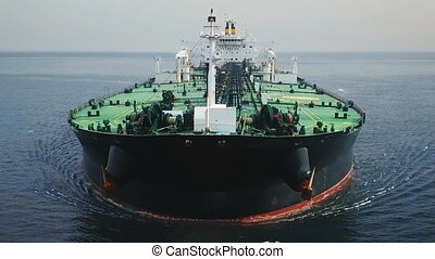 Bow and front deck of a tanker ship underway in the ocean....