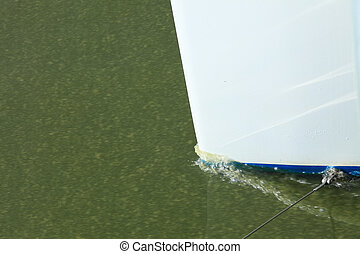 bow of a ship creates wake water