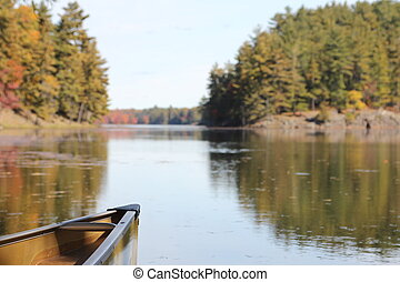 Bow of canoe on calm lake